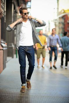 Shop this look on Lookastic: http://lookastic.com/men/looks/sunglasses-watch-v-neck-t-shirt-longsleeve-shirt-jeans-derby-shoes/5594 — Black Sunglasses — Silver Watch — White V-neck T-shirt — Grey Long Sleeve Shirt — Navy Jeans — Brown Leather Derby Shoes