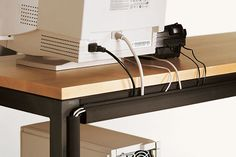 Cord Management from Room & Board. Combine the horizontal with the Leg component to get maximum coverage.