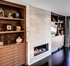 built in bars next to fireplaces | Ideas for contemporary fireplace with built-ins and TV nook.