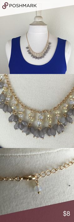 Feminine Stone Dangly Statement Necklace w/ gold The perfect neautral and feminine piece that goes with everything! Necklace has bright gold hardware and light grey and dark grey stones. I took the tag off but have actually never worn it Francesca's Collections Jewelry Necklaces