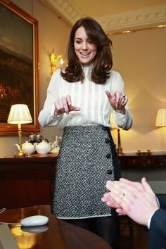 17 February 2016 - The Duchess of Cambridge wore a high-necked blouse and tweed skirt to support the launch of Young Minds Matter, by guest-editing the Huffington Post UK at Kensington Palace.