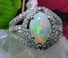 Opal and diamond ring. Opals are by far my favorite