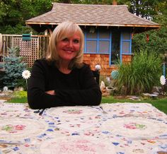 Me at my outdoor mosaic table.