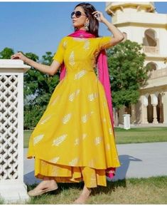 Shop online Yellow Leaf foil printed suit set Adorn yourself with this leaf motif block foil printed kurta and pink dupatta. Indian Fashion Dresses, Dress Indian Style, Indian Outfits, Designer Party Wear Dresses, Kurti Designs Party Wear, Gharara Designs, Stylish Dress Designs, Stylish Dresses, Pakistani Dress Design