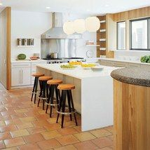 Looking for a way to add space to cook and gather in your kitchen? These 14 spaces have one thing in common: stylish islands. | archdigest.com