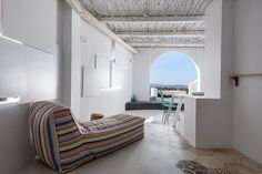 the renovation intends to revitalize the existing shell, highlighting the traditional morphological elements of the cycladic architecture with the us of a modern language.