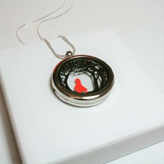 This tiny double layered papercut depicts Little Red Riding Hood walking through the forest. The entire dual layered papercut measures no more than 30 mm and is displayed in a gorgeous, rhodium plated zinc alloy, glass floating locket pendant. Little Red Hen, Floating Lockets, Red Riding Hood, Paper Cutting, Silver Plate, Washer Necklace, Unique Gifts, Craft Projects, Walking