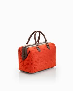 Doctor Satchel by ShoeMint.com in persimmon. got this purse to go with the perfect pair of shoes.