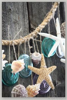 An easy to make garland of glass, shells and starfish that can be hung from the main table, the buffet table or anywhere you think needs some color. - See more at: http://www.beachwedding-guide.com/beach-wedding-decorations.html#sthash.8NFcURaj.dpuf