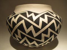 """Acoma Pueblo Pottery made by Margaret Seymour. Large white Acoma Pottery with a more 'open' painted design. Pot is approximately 7 1/2"""" tall, and 10"""" in diameter."""