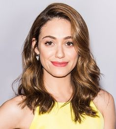 Emmy Rossum's light strands and coral lip are the perfect match