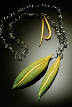 Kathleen Dustin -   polymer with 22K gold leaf and oxidized sterling.
