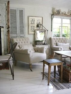 tufted chairs shutters trophies on shelf above window Cottage Living Rooms, Home And Living, Living Spaces, Small Living, Shelf Above Window, Salons Cottage, Cottage Shabby Chic, Interior Decorating, Interior Design