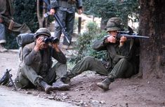 A Marine sniper takes aim from behind a tree as his comrade looks through a pair of binoculars to establish the enemy position during the Battle of Hue in 1968. (John Olson/Stars and Stripes) #Vietnam #VietnamWar #warphotography #photography #BattleofHue #1968 #USMC #Marines #starsandstripes