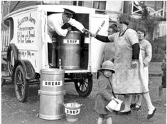 The Salvation Army responded to the great economic depression of the early 1930s with many new and creative services. At this mobile soup kitchen in Auckland, a woman passes a billy to be filled with soup, while her child waits to fill two jugs. The sign on the side of the van promises 'Hot Soup and Bread for Poor Families'. There weren't many places available for those needing assistance during the Depression. The Salvation Army fulfilled that need.