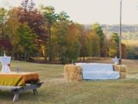 Love the haystack couch. Create a comfortable outdoor lounge—and photo op—by stacking bales into a custom couch. We supplemented wooden chairs provided by a rental company with bales of wheat straw. It's moveable, stackable, marries well with our outdoor decor—and could be used as  mulch  in our garden afterwards.