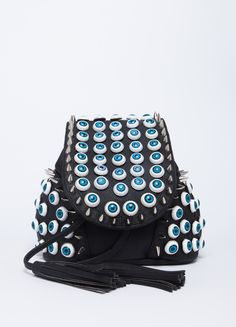 """Faux leather backpack from UNIF featuring eyeball and spike details with fringed drawstring. Snap button closure at front.    100% PU  12"""" width, 10"""" height"""