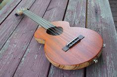 Semi-hollow, electric tenor ukulele in Zebrawood and Padauk. Includes a K Sound Twin Spot pickup