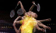 China's Wang Yihan returns a shot to compatriot Li Xuerui during their women's singles badminton gold medal match