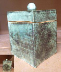Ceramic box. Iron oxide stain with true celadon glaze fired come 5 on white clay. By Linda Sciascia