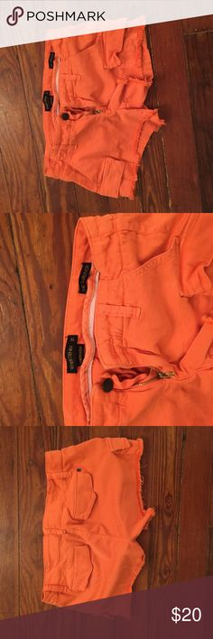 Genetic denim cargo shorts Worn and washed once, fits more like a 26. Color is reddish orange. Genetic Denim Shorts Cargos