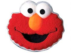 Aww, it's Elmo exactly as we know him -- furry fuzz and all. Your make-it-easy shortcut for this masterpiece is an Elmo Face Cake pan, which takes care of all the difficult-looking shaping. After baking, it's all paint-by-numbers: fill the nose with orange-colored icing, the eyes with white and the mouth and pupils with black. Then, use a star-shaped nozzle to make the furry red icing for the face.