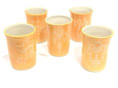 Golden yellow carved porcelain tumblers by Paula Focazio on etsy.