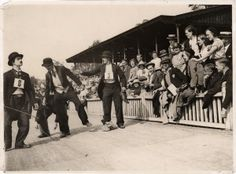 Traders dressed as Charlie Chaplin during a sports day.
