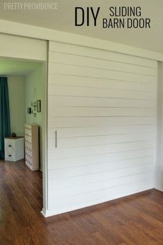 build an extra large sliding barn door with hidden hardware to close off an office - Pretty Providence