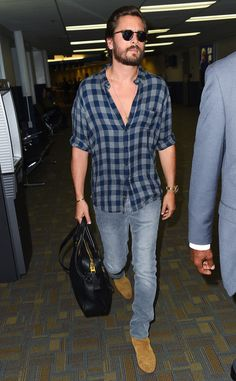 Scott Disick kept things casual in a plaid top, jeans and vintage-inspired round tortoise sunnies post-Las Vegas.