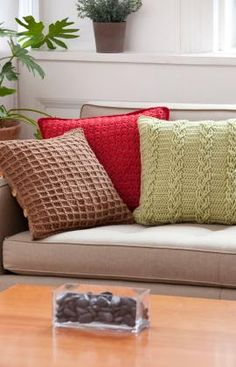 "FREE PDF PTRN: CROCHET, INTERMEDIATE Pattern #LW3068 'Textured Pillow Trio'. YARN: RED HEART® Soft™: 3 balls 4608 Wine A, 1882 Toast B, or 9522 Leaf C. GAUGES: 12 sts = 4""; 8 rows = 4"" in Subtle Texture pattern. 13 sts = 4""; 8 rows = 4"" in Waffle Weave pattern. 12 sts = 4""; 10 rows = 4"" in Braided Cables pattern.   HOOK: 6mm [US J-10]. SZ.18""X18"" sq."