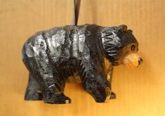 This charming wood Black Bear ornament will look right at home on your Christmas Tree. This Carved Wood ornament is sure to delight children, family, and friends around the holiday season. A great way