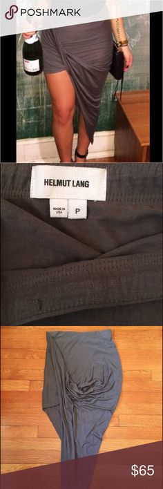 """Authentic HELMUT LANG High-Low Skirt Wore only once on NYE two years ago (lol @ my champagne) ! Rough cut edges and elastic waist strap - Size small petite. Looks way better on than hanging! I'm 5'3"""" - get a better feel of fit in the image. More of an army green/gray color. One small pull on the inside of the waist band and isn't visible when wearing; pictured above. Helmut Lang Skirts High Low"""
