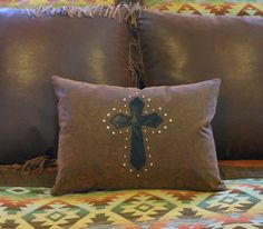 Beautiful tooled leather and Swarovski crystal cross western pillow by Lizzy & Me | Stylish Western Home Decorating