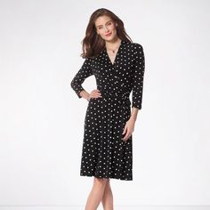 Black polka-dotted fabric ups the anti on this classic wrap dress. Just add a pair of heels and you are set for any spring event. This vintage style black polka-dotted dress features:• V-shaped neckline• Faux-wrap-front dress• All-over polka dot print• Belted waist• Straight hemline #dress #springdresses #polkadot #womendresses