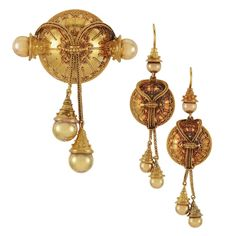 magical...Pair of Archaeological Gold Pendant-Earrings and Brooch   Fashioned of domes decorated with granulation, surmounted by braided chains tipped by gold balls, circa 1860, approximately 15.4 dwt.