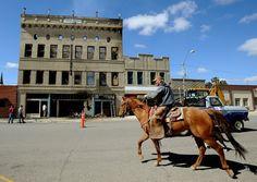 Volunteer firemen in Montana arrive on horses vs fire trucks!