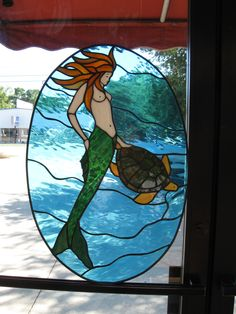Custom stained glass window of a mermaid and turtle. Created by Designer Art Glass in Daytona beach Fl