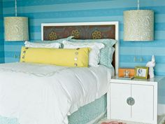 Beachy Striped Bedroom: Oversize drum shades help to balance the linear walls, headboard, and nightstands in this Laguna Beach bedroom. The bright striped wallpaper look can be achieved with paint by choosing vibrant colors in at least 4-inch-wide stripes.