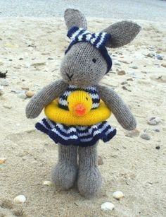 Bunty Bunny Rabbit Goes Swimming pdf email toy knitting pattern by debi birkinBunty Bunny Rabbit Goes Swimming By Debi Birkin - Purchased Knitted Pattern - (ravelry) ~ this is so cute - love the duck around her waist adorable!this is a knitting patte Knitting For Kids, Knitting Projects, Baby Knitting, Crochet Projects, Knitting Patterns, Crochet Patterns, Finger Knitting, Scarf Patterns, Knitting Tutorials