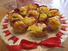 Bacon, ham, hash & cheese egg cups.  Made in mini-muffin pan.  So delish!