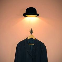 René Magritte InspiredJeeves Bowler Hat Wall Fixtureby Innermost. See more ideas in 22 Old Things That Make Awesome DIY Lamps.