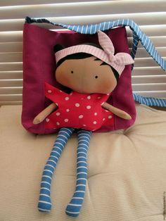 Купить или заказать Сумочка с куклой в интернет-магазине на Ярмарке Мастеров. Сумочка для девочки сшита полностью из хлопковых тканей. Куколка вынимается из кармашка-рюкзака, можно посадить. Ручки крутятся. Повязка снимается с головы. Сумка на подкладке, помещает в себя кучу всяких мелочей. Душевный подарок маленькой моднице, наполненный теплом человеческих рук.
