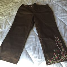 Brown pants with embroidered flower embellishment Brown pants with embroidered pink, green and white flower embellishment on front of left leg and at right waist. Never worn! Venezia Pants Straight Leg