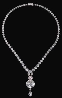 IMPORTANT LIGHT PINK DIAMOND AND DIAMOND NECKLACE. Suspending a detachable pendant set with two marquise diamonds, a brilliant-cut light pink diamond weighing 6.93 carats, two circular-cut diamonds, one weighing 34.78 carats, and a briolette diamond weighing 11.38 carats, from a graduated circular-cut diamond rivière with a step-cut diamond clasp, length approximately 555mm. by gertrude