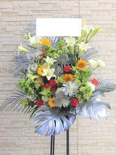開店祝いにシルバーの葉物を使ったスタンド花はいかがですか?大阪市住之江区の花屋 Fairytaleの花スタンド。季節の花を使って華やかにお作り致します。開店祝い・周年祝いにスタンド花をお届け。 Funeral Flower Arrangements, Funeral Flowers, Floral Arrangements, Green Plants, Air Plants, Altar Flowers, Bouquet Wrap, Flower Stands, Florists