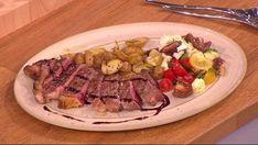 Sliced sirloin steak with Italian roast potatoes and tomato