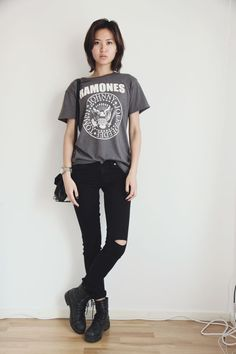 Shop this look for $105:  http://lookastic.com/women/looks/charcoal-crew-neck-t-shirt-and-black-skinny-jeans-and-black-boots-and-black-crossbody-bag/1651  — Charcoal Print Crew-neck T-shirt  — Black Skinny Jeans  — Black Leather Boots  — Black Leather Crossbody Bag