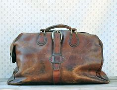 Vintage Distressed Leather Travel Bag from You're Welcome