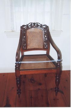Chair 1 of set of 7. Chinese export teakwood chair with cane seat and back, pierced, carved, foliated crest and foliated supports.  Sheraton style. On view in the Durand Room at the Atwood House Museum, Chatham, MA. #19thcentury, #chineseexport, #chair, #chatham, #atwoodhouse, #capecod
